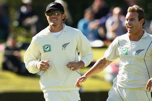 Time Southee, left, and Doug Bracewell, right, celebrate a wicket. Photo / Getty Images
