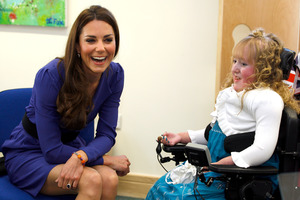 Britain's Duchess of Cambridge meets Bethany Woods in a music class during a visit to The Treehouse in Ipswich. Photo / AP