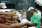 Tiger Woods signs autographs for fans after a round at Bay Hill. Photo / AP