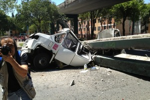 A truck lies crushed by part of a bridge after the 7.6 quake. Photo / Twitter/ @ENRVA