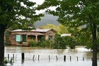 A house is swamped under floodwaters in Kaeo. Photo / Laura Jerome