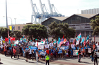 Protesters march as part of Ports of Auckland industrial action earlier this month. Photo / Doug Sherring