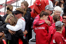 Camper crew members say their last goodbyes to their families before the Volvo Ocean Race fleets heads into the Southern Ocean bound for Brazil. Photo / Richard Robinson
