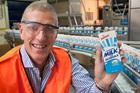 Fonterra business manager beverages, Craig Irwin, reveals the  Milk for Schools 250ml carton. Photo / Supplied