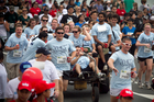 Auckland University engineering students take a novel approach to the run. Photo / Natalie Slade