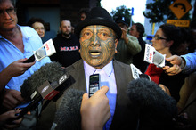 Tame Iti talks with media outside the High Court in Auckland after he was found guilty on some charges in trial regarding the Urewera Raids.  Photo / Greg Bowker