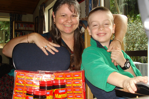 Louise Martin and her autistic son Daniel, who is sensitive to foods and eats Marmite every day.  Photo / Supplied