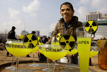 A South Korean, Obama-masked activist protests about nuclear power plants. Photo / AP