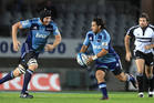 Blues players Ali Williams and Piri Weepu in action during the game against the Hurricanes. Photo / Greg Bowker