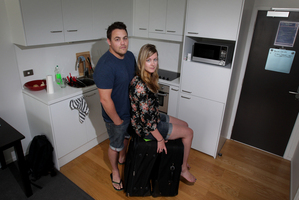 Jenn Laidlaw and Simon Kear are living out of their suitcases while their possessions tour the country. Photo / Sarah Ivey