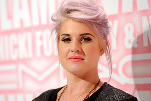Kelly Osbourne says she was 'body slammed' by paparazzi but was even more cross when he proceeded to question her about her brother's dead dog. Photo / AP