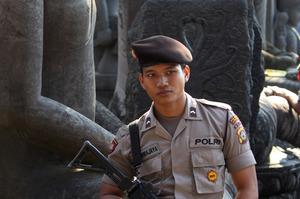Indonesian police stand next to statues of Buddha near Kerobokan prison in Denpasar, Bali. Photo / AP