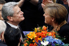 Joachim Gauck with Angela Merkel - the first East Germans to hold the positions of President and Chancellor. Photo / AP