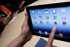 The new Apple iPad has been accused of being too hot to hold. Photo / AP