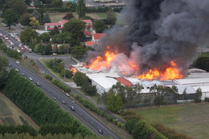 Flames engulf the Icepak Coolstores plant at Tamahere. Photo / APN