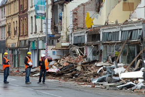 Construction workers survey damage in central Christchurch. The earthquake and the Rena wreckage pushed up domestic business travel last year. Photo / Simon Baker
