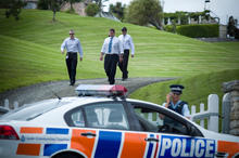 Detectives leave Kim Dotcom's house in Coatesville, Auckland. Photo / APN