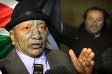 Tame Iti makes a point to the media outside the High Court at Auckland. Photo / Greg Bowker