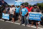 Members of the Maritime Union and Auckland port workers protest on Tamaki Drive. Photo / Sarah Ivey