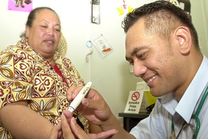Mata Vaipo is tested for diabetes by student nurse Kora Collin in Rotorua. Photo / APN