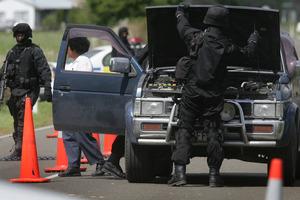 A roadblock in the Ruatoki Valley during the anti-terrorism raids. Photo / Alan Gibson