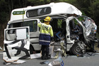 A Spanish couple died instantly when a southbound truck and trailer slammed into their white campervan near Towai in late 2009. File photo / NZ Herald