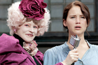 The performance by Jennifer Lawrence (right), here with Elizabeth Banks, in The Hunger Games is strong, moving and nuanced. Photo / Supplied