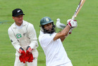 Hashim Amla of South Africa bats while Kruger van Wyk of New Zealand looks on during day one of the Third Test match between New Zealand and South Africa. Photo / Getty Images.