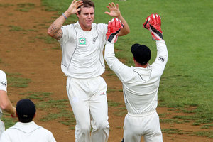 Doug Bracewell of New Zealand celebrates the wicket of Graeme Smith of South Africa during day one of the Third Test match between New Zealand and South Africa. Photo / Getty Images.