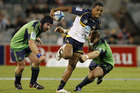 Henry Speight of the Brumbies fends off a tackle during the round five Super Rugby match between the Brumbies and the Highlanders. Photo / Getty Images.