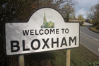 A sign welcomes visitors to Bloxham in Oxfordshire, where Jim Eagles' ancestors hail from. Photo / Alison Smith