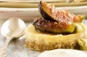Lemon cheesecake with passionfruit and grilled figs. Photo / Babiche Martens