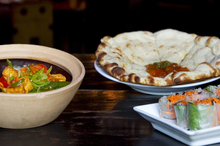 Monsoon Poon's Sichuan claypot with Vietnamese spring rolls and aloo naan.  Photo / Natalie Slade