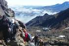 Travellers out for a bit of summer climbing on Mt Ruapehu. Photo / Supplied