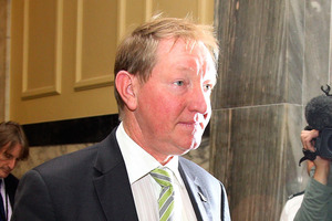 Nick Smith fronts up to the media after giving his resignation at Parliament today. Photo / Getty Images