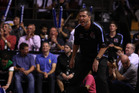Breakers coach Andrej Lemanis yells at the team from courtside while fans cheer them on with thundersticks. Photo / Getty Images