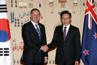 South Korean President Lee Myung-bak shakes hands with New Zealand Prime Minister John Key during their meeting at the Presidential house on March 25 in Seoul.  Photo / Getty Images.