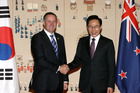 John Key is greeted by South Korean President Lee Myung-bak. Photo / Getty Images