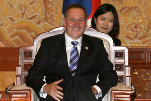 Prime Minister John Key attends a meeting with the South Korean president. Photo / Getty Images