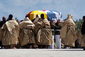 The body of King George Tupou V is taken from the plane after arriving in Tonga on a flight from Hong Kong. Photo / Sarah Ivey
