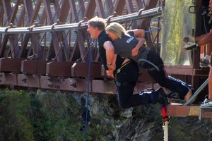 The English entertainer takes the plunge in a triple jump from Kawarau Bridge. Photo / Supplied