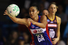 Maria Tutaia of the Mystics passes the ball out during the ANZ Championship match between the Mystics and the Firebirds in 2011.  Photo / Getty Images.