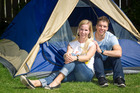 German backpackers Annika Reitemeier and Markus Kaufmann have set up camp in a New Zealander's backyard. Photo / Richard Robinson