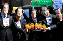Protesters wearing masks of world leaders protest against the Nuclear Security summit in Seoul. Photo / AP