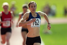 Nikki Hamblin comfortably wins the national 1500m title yesterday but her time of 4m 19.63s was well outside the Olympic qualifying mark. Photo / Brett Phibbs