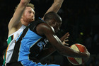Luke Schenscher of the Crocodiles blocks Cedris Jackson of the Breakers during game one of the NBL finals series.