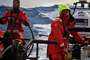 Chris Nicholson from Australia helming and Tony Rae from New Zealand grinding onboard CAMPER. Photo / Hamish Hooper.