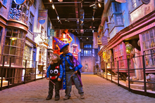 Zac and Sasha Jourdan explore the stores of Diagon Alley at the 'Warner Bros. Studio Tour London: The Making of Harry Potter' tour. Photo / Amy Laughinghouse