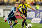 Scott Jamieson of Sydney FC tackles Manny Muscat of the Phoenix during the A-League Elimination Final match. Photo / Getty Images.