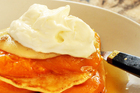Top poached fruit pancakes with cream or mascarpone. Photo / Janna Dixon